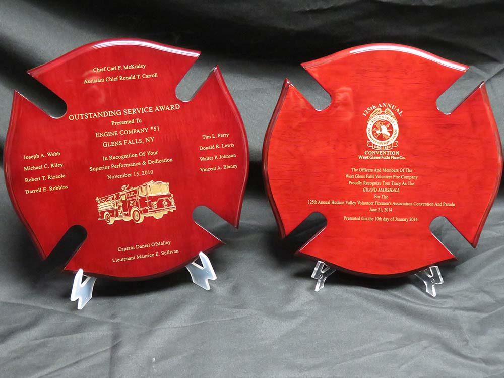 2 red fireman plaques