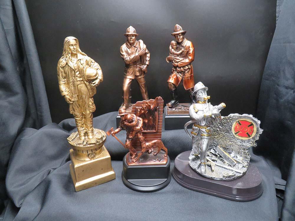 Metal fireman trophies