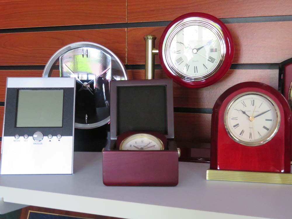 Digital and analog clocks on shelf
