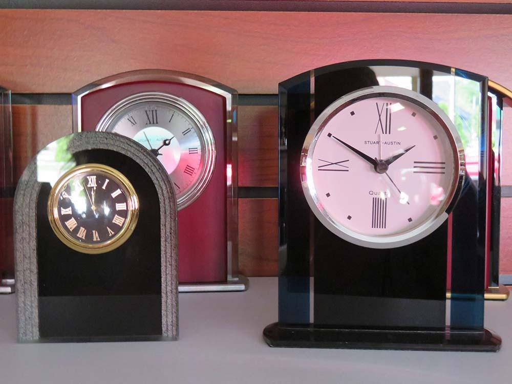 Analog clocks on shelf