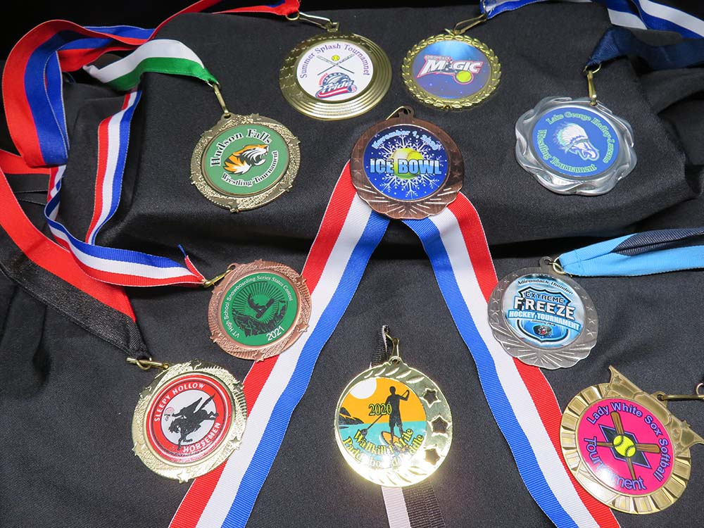 variety of medals with ribbons