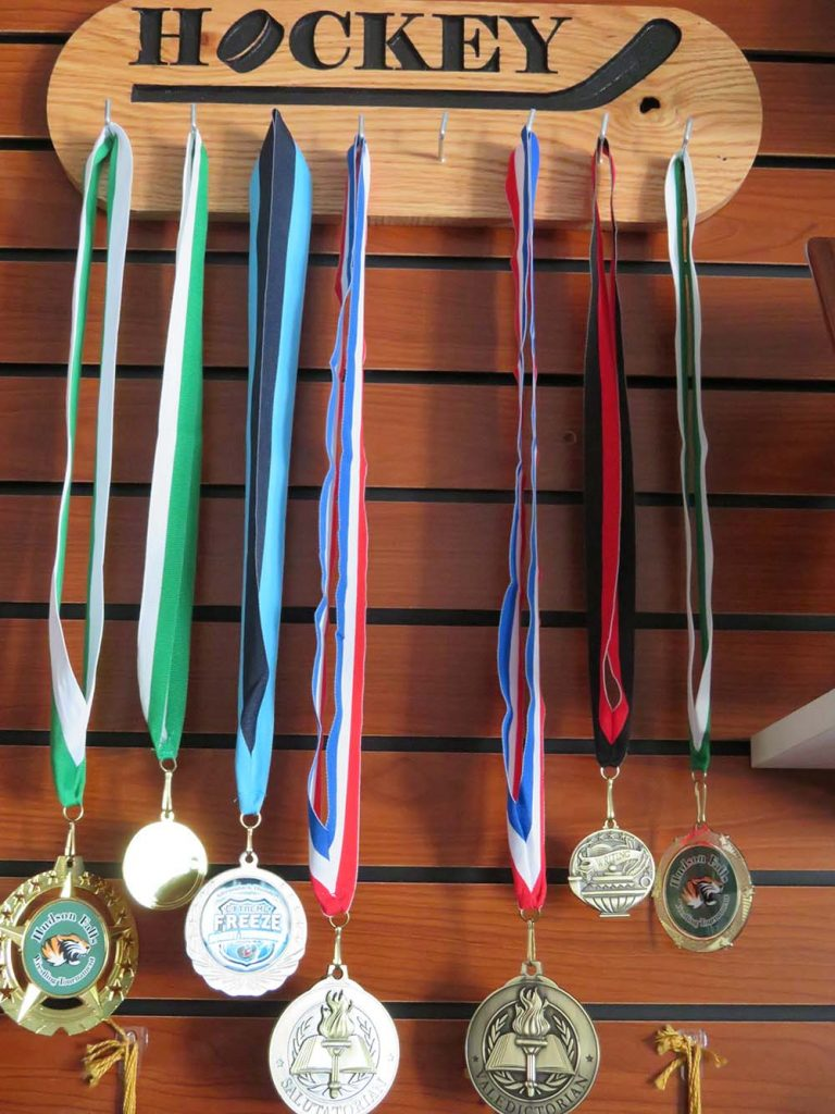 Hockey medals with ribbons hanging