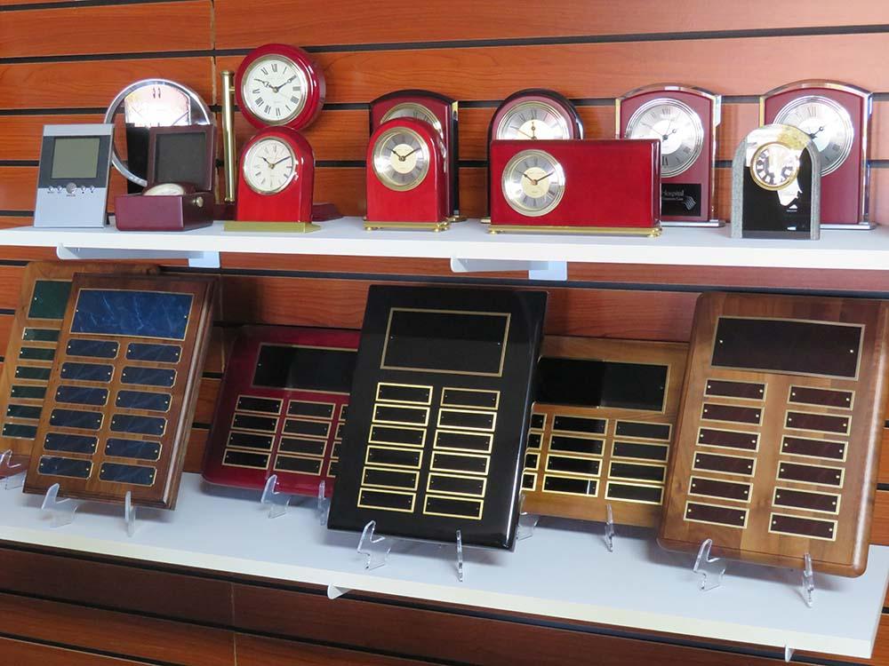 Blank plaques on clocks on display