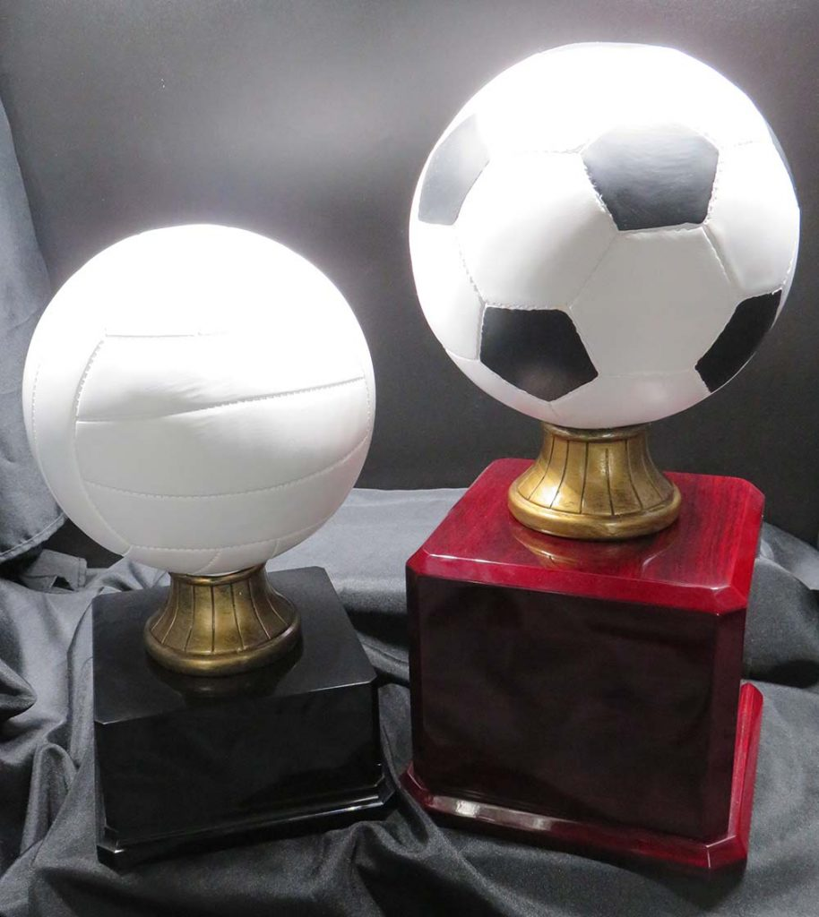 soccer and volleyball trophies