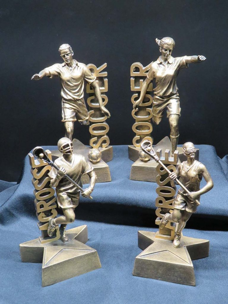soccer and lacrosse trophies