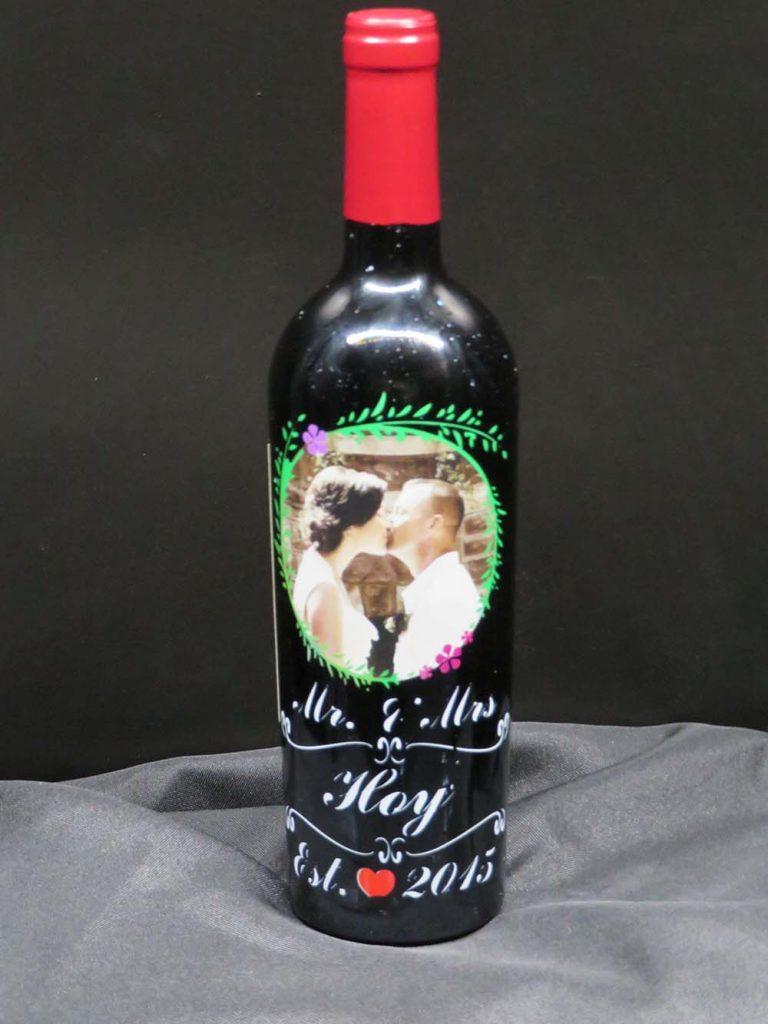 Wine glass with label celebrating wedding anniversary