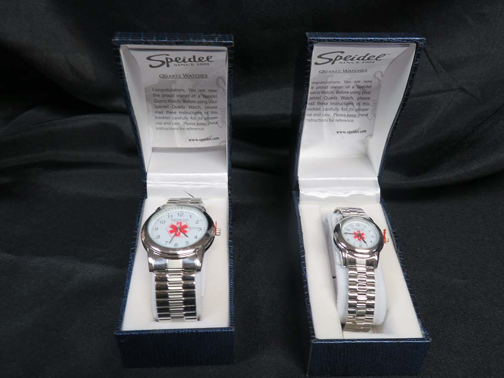 Silver watches in boxes