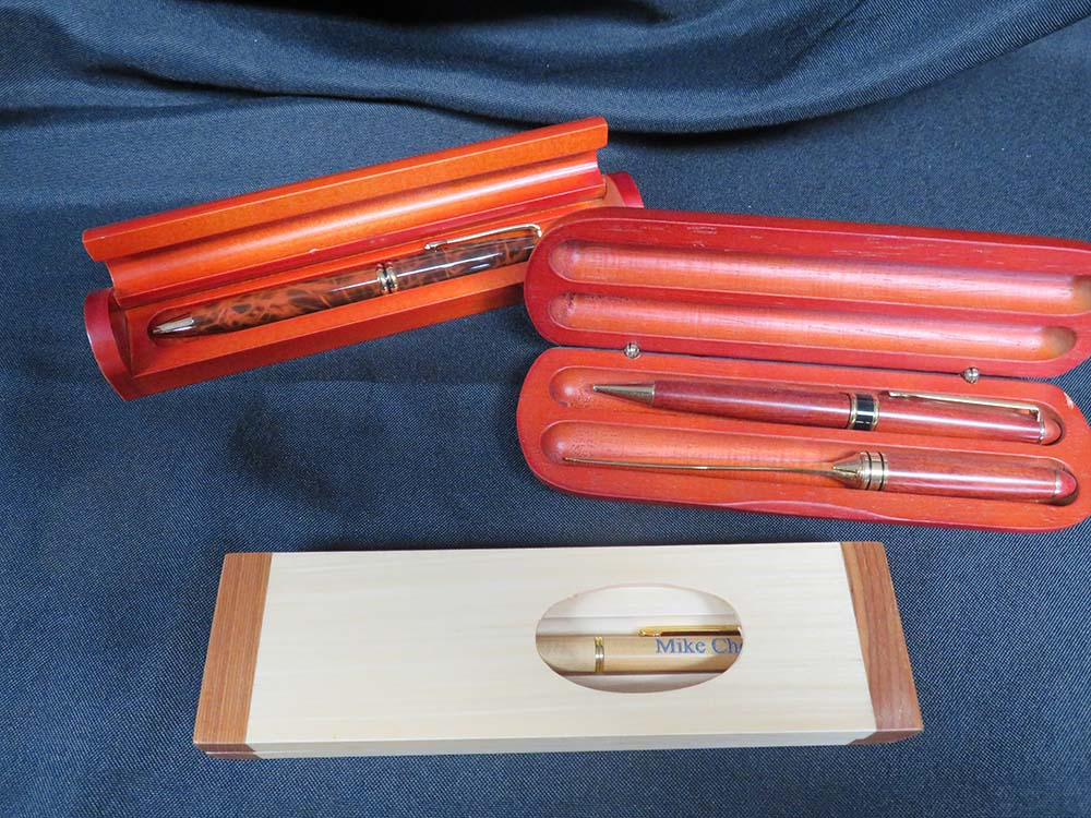 wooden pens in wood cases