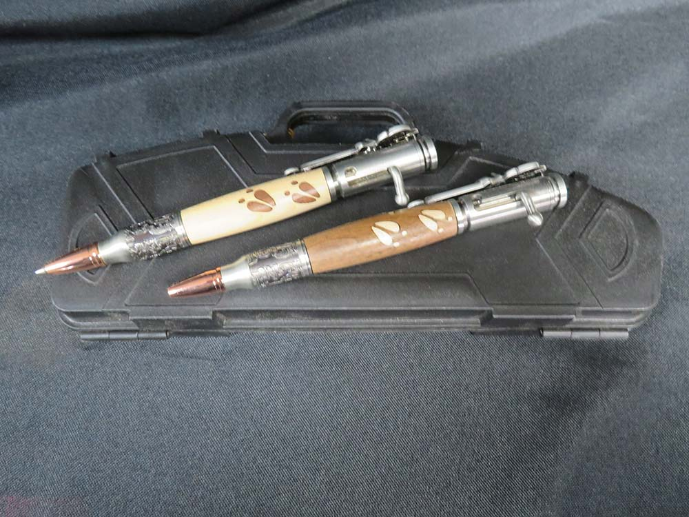 2 metal and wood pens on case