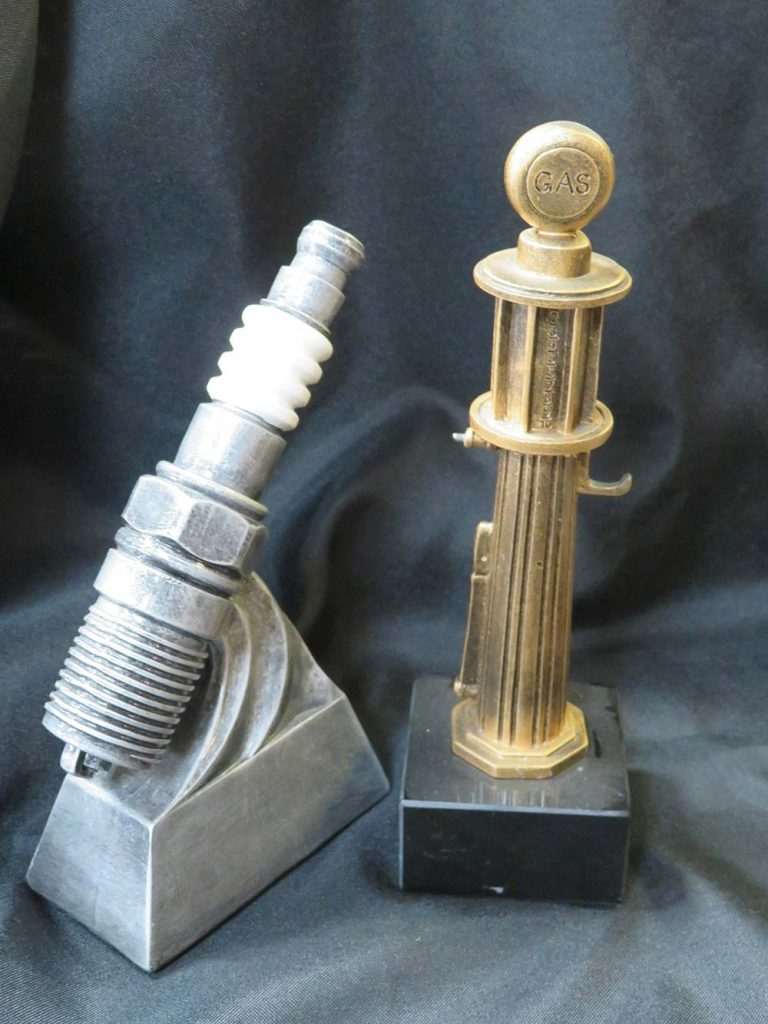 car show trophies, spark plug and gas pump