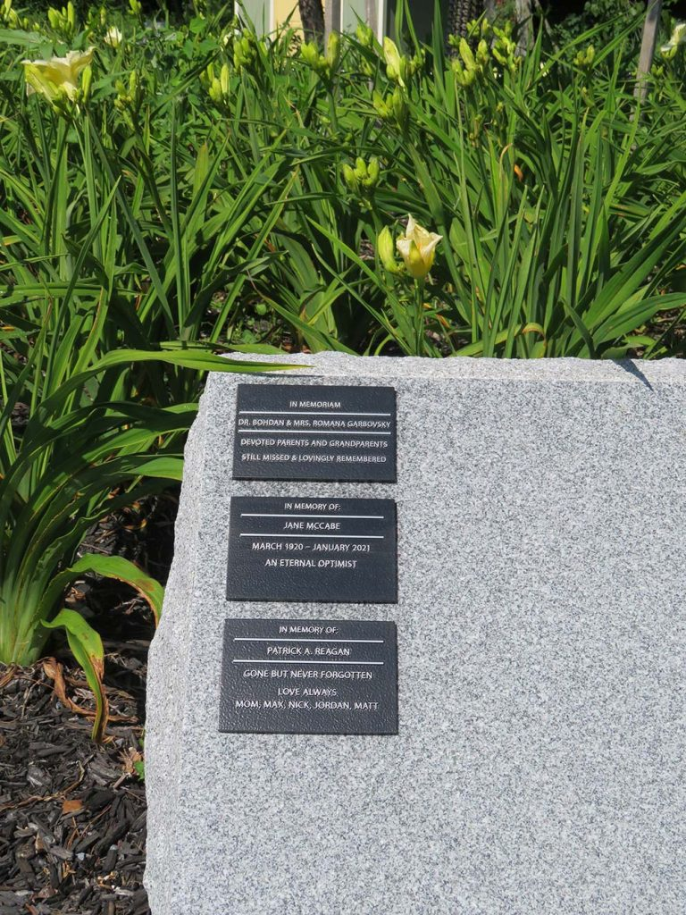 memorial with 3 cast plaques