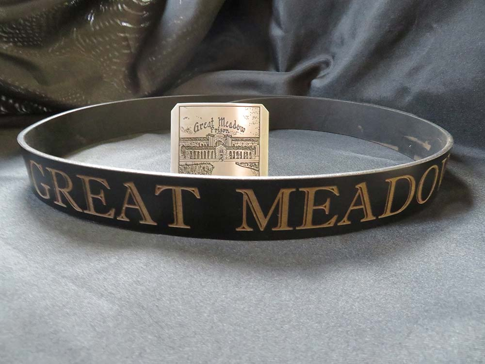 Belt with cast buckle